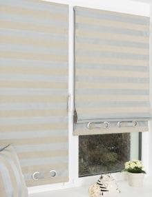 Миниримские шторы в полоску и дероративными люверсами на окне с установкой без сверления
