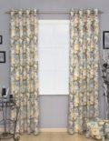 Шторы на люверсах из ткани с желтыми цветами на голубом фоне