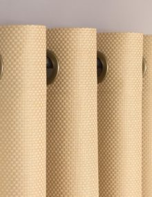 Шторы на люверсах песочного цвета из ткани блэкаут